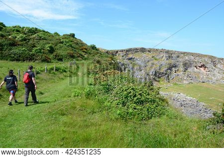 Llandudno, Uk: Jun 17, 2021: Hikers Climb A Path Up The Little Orme On A Sunny, Late Spring Day. The
