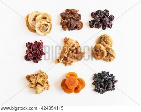Various Dried Fruits Heaps. Dried Or Sun-dried Berries And Fruits On White Background. Vegan Healthy