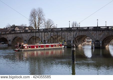 A Narrowboat Passing Underneath Maidenhead Bridge In Berkshire In The Uk, Taken On The 30th March 20