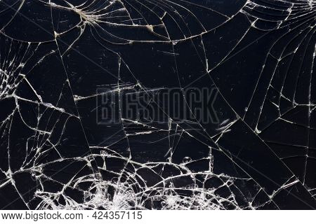 Broken Glass Texture With Cracks. Black Cracked Screen Of Smartphone