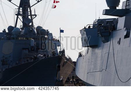Warships - An Italian Frigate And An American Destroyer Moored At A Seaport Wharf