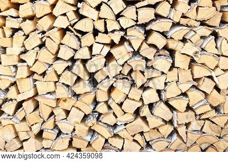 A Lot Of Firewood Stacked Evenly, Texture. Dry Birch For Furnace. Logs Background. Wooden Birch Logs