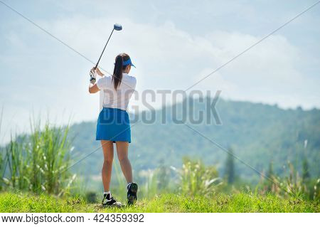 Female Golf Player Hitting Golf Ball On Fairway, Lifestyle Woman Playing Game Golf Healthy And Sport