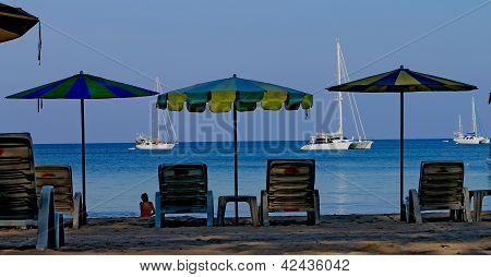 Sun umbrellas and boats