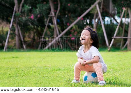 Portrait Image Of 4 Baby Child. Happy Asian Kid Girl Sitting On White-blue Ball On Nature Green Park