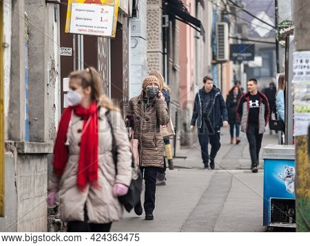 Belgrade, Serbia - February 20, 2021: Old Senior Woman Wearing A Respiratory Facemask, Calling Using