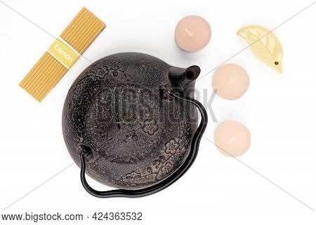 Vintage, Black Metal Japanese Tea Pot Isolated On White Background With Tea Candles. Minimalistic Te