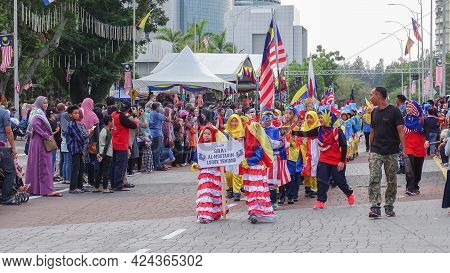 Labuan,malaysia-sept 16,2018:kids Wearing Costumes Made From The Malaysian Flag,marched During Malay