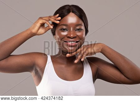 Essential Beauty. Beauty Portrait Of Happy Young African Female With Flawless Skin