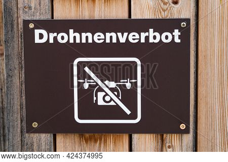 Warning Sign Prohibiting Drones From Flying In The Swiss Tourist Area. Translation Of The German Sig