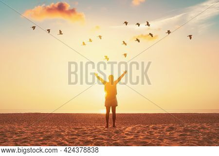 Copy Space Of Woman Raise Hand Up On Sunset Sky At Beach And Island With Birds Flying Abstract Backg