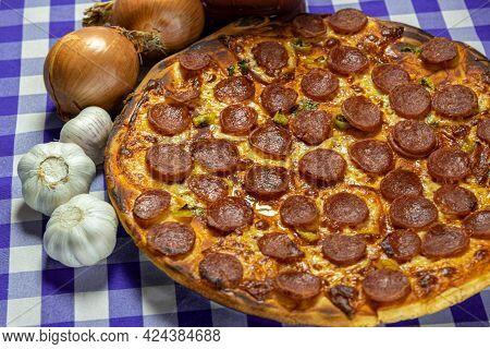 Pepperoni And Cheese Pizza And Tarantella Sauce.