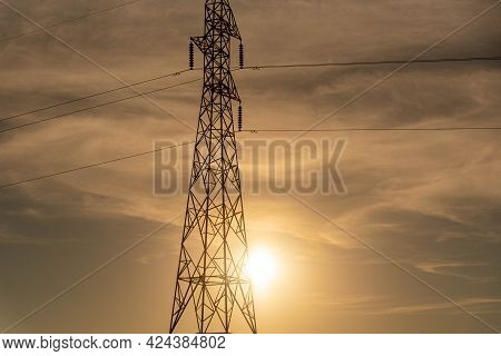 Electric Power Tower And The Sunset