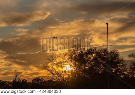 Dramatic Sky And Sunset Silhouette In A Mall Parking Lot In Brazil