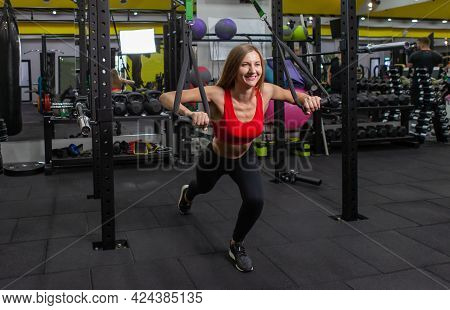 Functional Training. Healthy Lifestyle Concept. Slim Fit Woman Doing Exercise With Trx Straps. Young