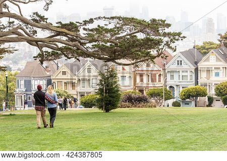 San Francisco, California - July 24, 2018: A Couple Of Tourists Enjoying The View Of Painted Ladies,