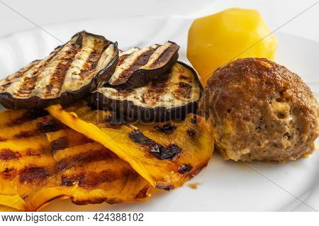 Grilled Vegetables, Cutlet And Potatoes On A Plate. Dinner For The Family. A Portion. Healthy Diet.