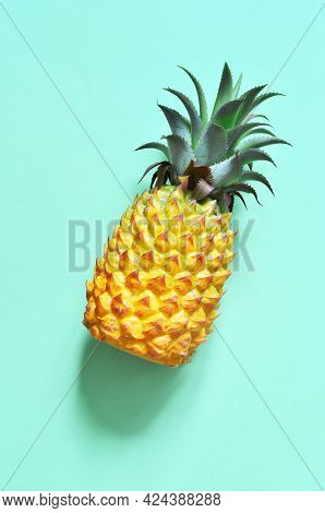 Yellow Pineapple On A Blue Background. Exotic Concept.