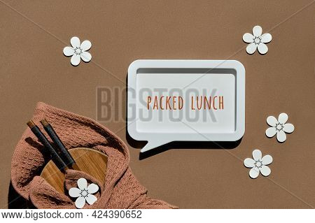 Text Packed Lunch. Zero Waste Packed Lunch Box Set On Brown Paper Background With Wooden Flowers. Lu