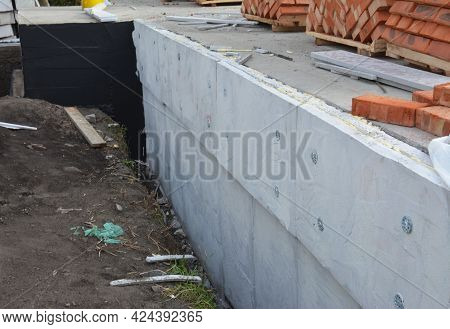 A Close-up Of An Exterior House Foundation, Basement Waterproofing And Insulation Applying Tar, Bitu