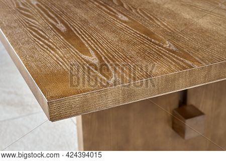 Large Empty Extendable Dining Table Made Of Light Toned Veneer And Solid Ash Timber On Open Terrace