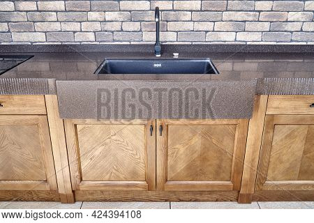 Comfortable Modern Summer Kitchen With Furniture Of Veneer And Solid Ash With Brown Acrylic Solid Su