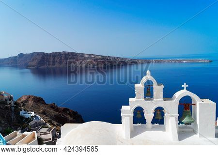 White Church Belfry Over Sea And Caldera, Santorini Island Greece