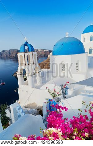 White Church Belfry, Blue Domes, Steps And Volcano Caldera With Sea Landscape, Beautiful Details Of