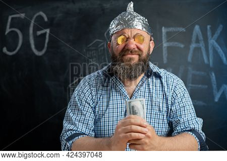 Bitcoins Coins In The Eyes Of A Man In A Foil Hat And Dollar Bills In The Hands Of A Conspiracy Theo