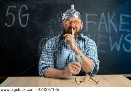Stupid Conspiracy Theorist With Bitcoin Coins In His Eyes And Dollar Bills In His Hand Closes His Mo