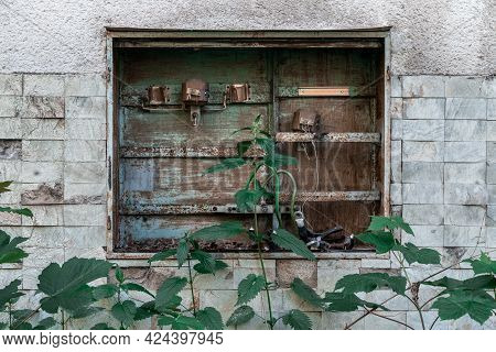 Detail Of An Old Electric Switchboard With Most Parts Missing, Built In A Facade Of A Very Old Aband
