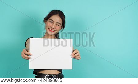 Blank Empty Paper Board In Asian Woman's Hand On Green Mint Or Tiffany Blue Background