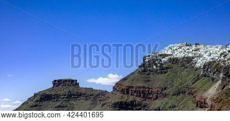 Santorini Island, Greece. Fira Caldera Over Aegean Sea, Blue Sky