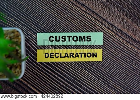 Customs Declaration Write On Sticky Notes Isolated On Wooden Table.