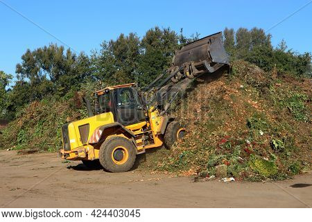Wheel Loader Working In A Composting Facility For Food Waste And Green Waste