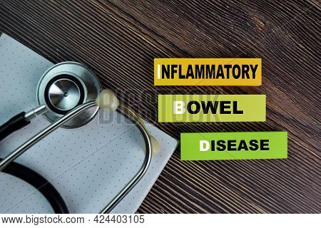Ibd - Inflammatory Bowel Disease Write On Sticky Notes Isolated On Wooden Table.