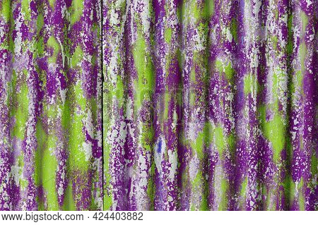 Colorful Motley Green And Purple Peeled Off Paint Layers On Corrugated Zinc Coated Steel Sheet Textu