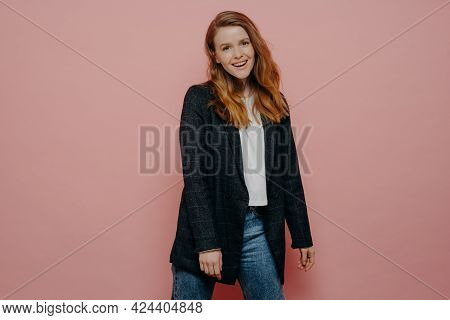 Stylish Fashionable Young Woman Wearing Plaid Blazer And Jeans Posing In Studio, Feeling Carefree An