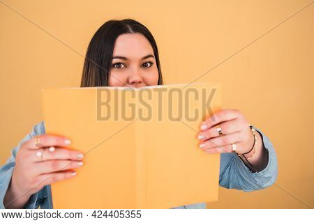 Young Plus Size Woman Reading A Book.