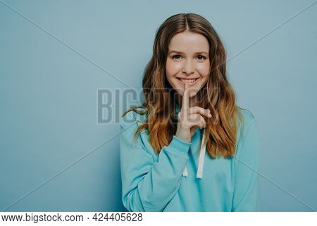 Attractive Young Teen Girl Smiling While Touching Lips With Pointer Finger Showing Shushing Sign Wea