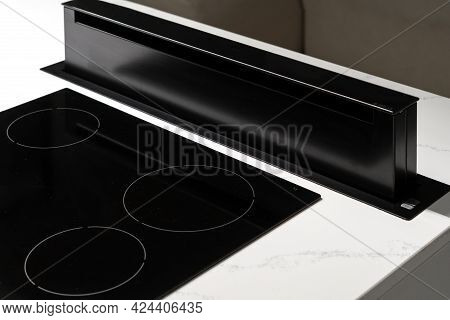 State Of Black Ceramic Induction Stove Top With Retractive Exhaust Device On Clean Countertop With W