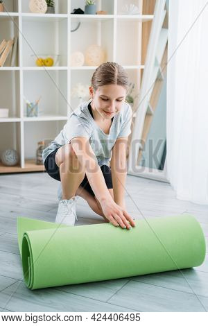 Active Children. Home Gym. Workout Routine. Morning Physical Exercise. Athletic Girl In Activewear U