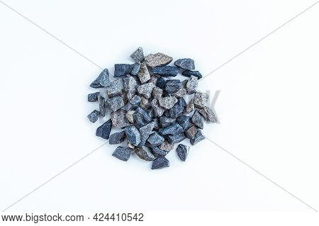 A Pile Of Small Rubble Close-up On A White Background. View From Above.