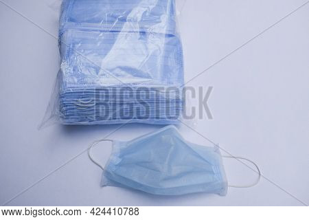 Package Of Many Blue Disposable Surgical Masks. Bundle Pack Of Surgical Masks During Pendamic Times