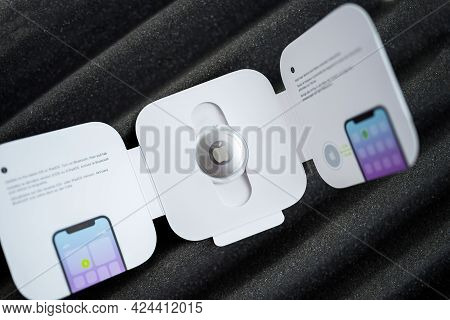 Paris, France - May 2, 2021: Package With New Airtag By Apple Computers - The Small Device Helps Peo