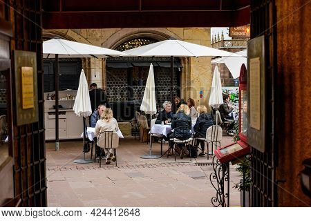 Strasbourg, France - May 19, 2021: People Eating Outside At Maison Kammerzell Iconic Restaurant As B