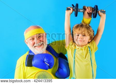 Family Sport. Grandpa And Son Workout Together. Kid Boy Raising Dumbbell. Grandfather And Child Spor