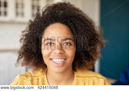 Close-up Portrait Of Attractive Dark-skinned Young Woman With Curly Afro Hairstyle, Natural Beauty M