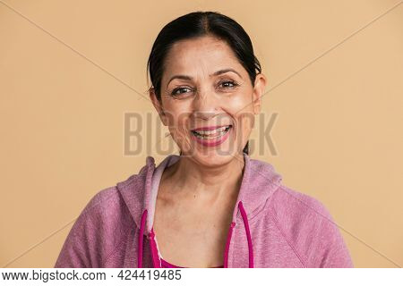 Happy Indian woman in a pink hoodie