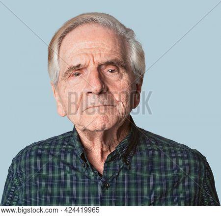Displeased senior man in a studio shoot mockup